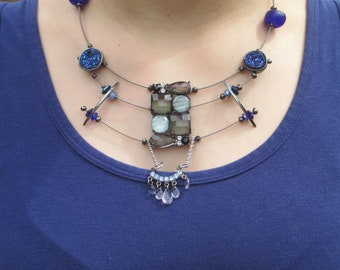 Bella, necklace is cool blues, silver guitar strings, layered, geometric, contemporary,textured, sculptural,handmade