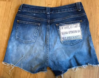 Cut off, bleached/ombre denim shorts with slogan patch pocket