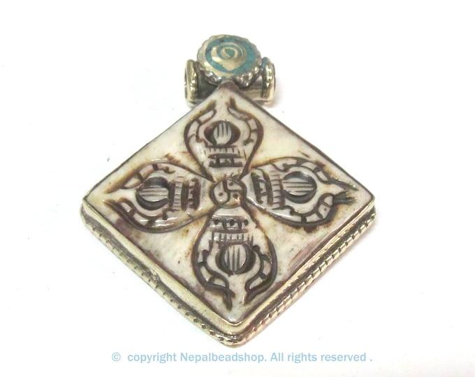 Ethnic Tibetan cream color carved double dorje symbol pendant - PM594D