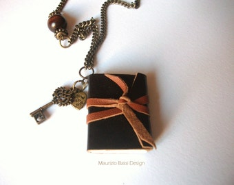 Necklace with pendant in the form of book made of leather