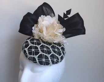 Gorgeous black fascinator with black silk abaca loops, cream netting and flower