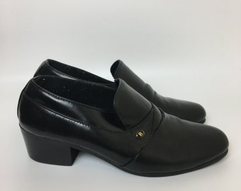 Shiny black leather loafers