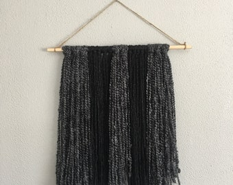 Black and charcoal wall hanging