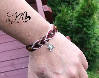 Friendship bracelet with cute little turtle