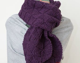knitted scarf with pompoms