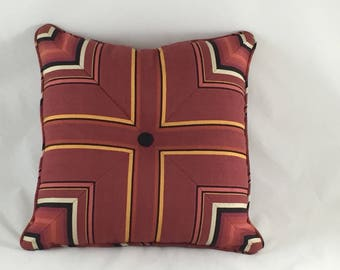 French rusty-red linen cushion with black button
