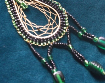 Beaded dreamcatcher with black and green