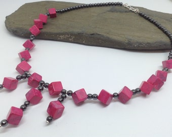A very vibrant pink magnesite and haematite beaded necklace.
