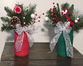 Christmas arrangements in painted mason jars