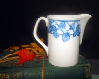 Vintage (c.1980s) and RARE! Studio Nova JJP07 Berry Delight creamer | milk jug.  Blue leaves, berries, flowers and trellis. Made in Japan