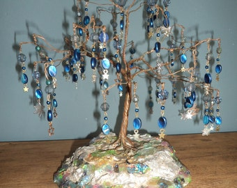 Blue star tree handmade from recycled copper wire.