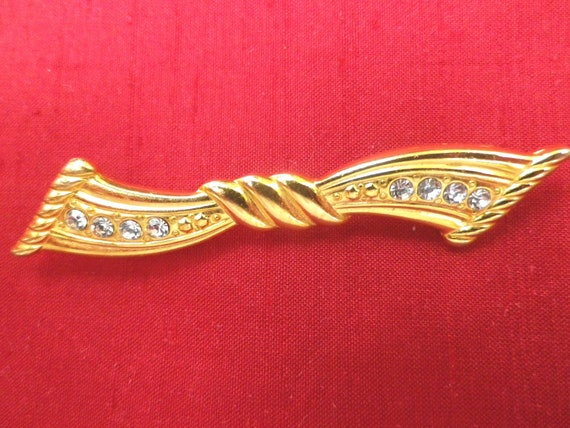 Gold tone bow brooch or lapel pin with diamante highlights