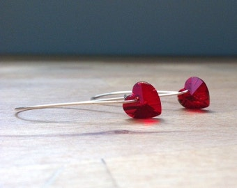 Red glass heart pendant on long kidney shaped earwires
