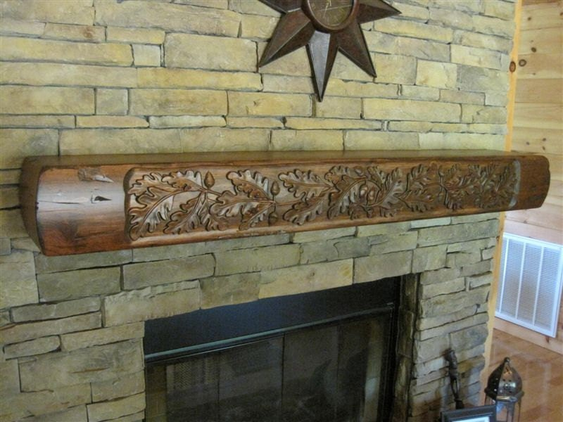 Rustic Fireplace Mantel With Carved Oak Leaves. Features Curved Front And Sides With A Flat Top