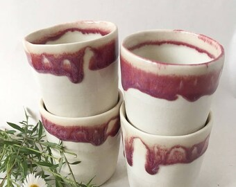 white and maroon drip ceramic small sized coffee cup