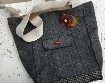 """Forager Bag """"Kootenay"""", approximately 40 cm tall, 30 cm wide and 16 cm deep, embellished with a removable woolen brooch."""