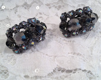 Smoky Grey Rhinestone Clip On Earrings, Small Flower Shapes at Edges with Aurora Borealis Centers, Curved Shape Clip On Earrings.
