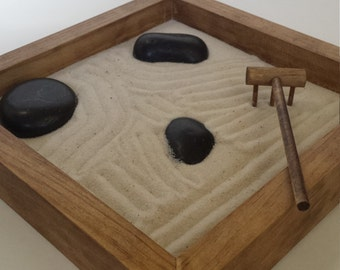 Zen Garden with Rake and Rocks