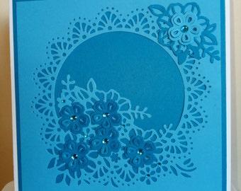 Light blue with dark blue flower Circle card
