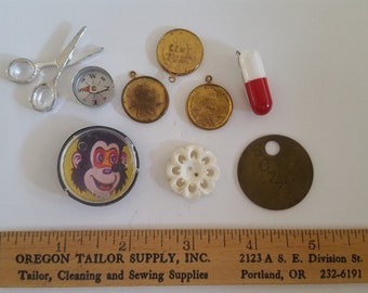 Vintage lot of 1950's to 1960's Crackerjack prizes, charms, tool tag and button all one price