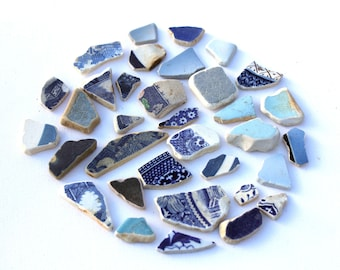 34 pieces of blue pottery (Various shades/shapes/sizes) perfect for mosaics or other crafts.