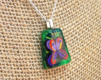 Hand painted resin pendant - purple & red butterfly on green foliage background - trapezoid shape