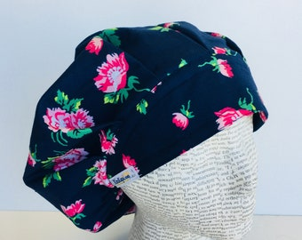Traditional Bouffant Scrub Cap scrub hat featuring a dark blue material with flowers in pink and green