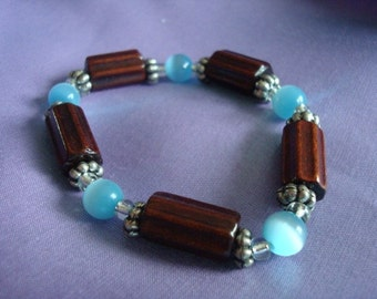 Bracelet with rectangle chocolate brown beads and cerulean blue glass beads.