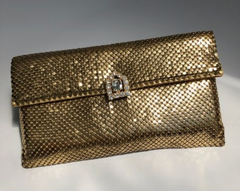 An amazing evening Whiting and Davis gold mesh clutch