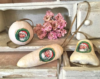 Ancient christmas ornaments made of cotton with a wreath of santa claus pictures