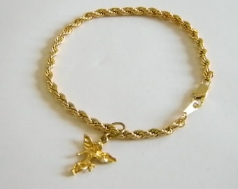 Gold Tone Rope Bracelet With Angel Charm