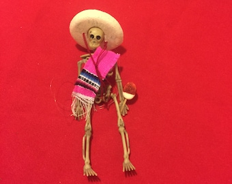 Pink Sarape day of the dead skeleton ornament with a jicaleta  jicama pop #10