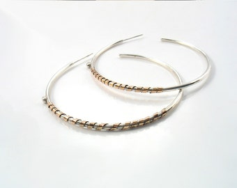 Big sterling silver and solid rose gold large hoop. 5.5 cm high silver Gypsy earring wrapped with a rose gold strap.