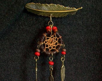 Pin feathers and dream catcher or dream catcher