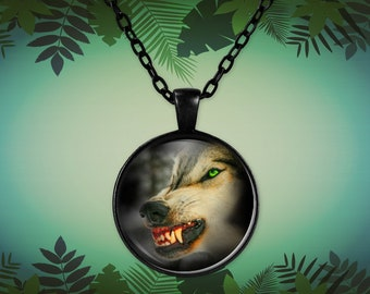 Angry wolf, beautiful up close photo showing sharp teeth on a round pendant necklace in black or silver