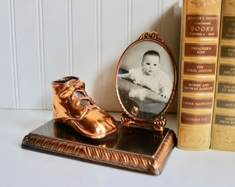 Copper baby shoe bootie with picture frame on beautiful antique patina base. Vintage bronzed memorabilia nursery shabby planter contain er