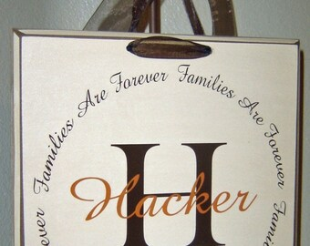 Families are Forever vinyl lettering circle, with your personalized monogram initial and family name on a board w\/ribbon