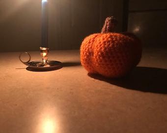 Two stuffed pumpkins