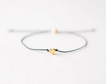 Black cord bracelet with gold heart