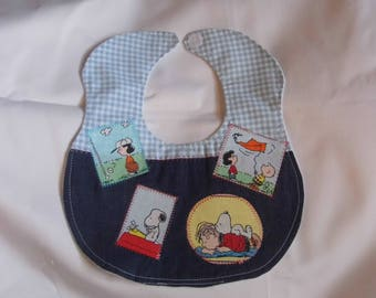 """Quilted baby bib """"Peanuts"""""""