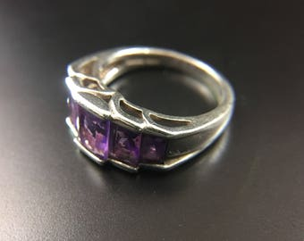 Sterling silver ring with amethyst stones, size 6.75, weight 4.4 grams