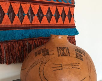 1991 Hopi Inscribed Gourd signed w/2 feathers