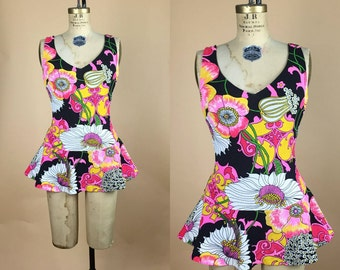 1960s. psychedelic. black and neon. floral. skirt bathing suit. with scoop back. small. AS IS