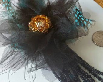 Topaz Swarovski in black and teal