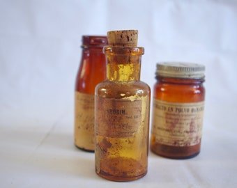 set of apothecary bottles with it's original label -different type of amber bottles- 1940's