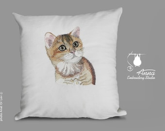 Pillow with embroidered cat.