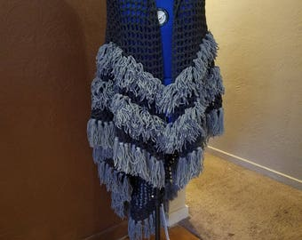 This beautiful hand crocheted shawl wrap, is dark gray with light gray fringes.