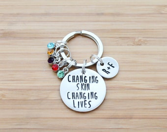 hand stamped rodan and fields keychain   changing skin changing lives