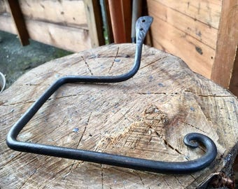Hand forged toilet roll holder with curl detail