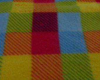 A Tisket A Tasket a perfect Picnic Blanket.  Colorful plaid fleece front with coordinating gradient yellow back  Approx Size 46x53